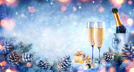 Christmas Celebration With Champagne - Flutes On Snow With Fir Branch And Bokeh 写真素材