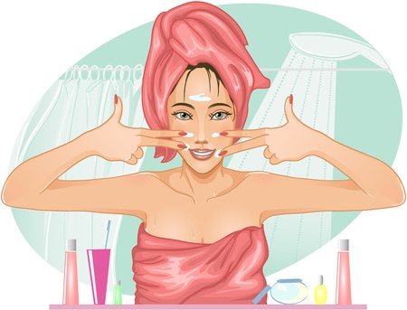 hand towel: image of a young beautiful woman who applies cream on her face in the bathroom. She makes a joke, posing.