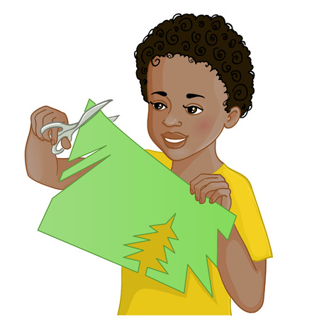 color separation: African American boy is cutting color paper with scissors