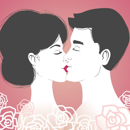 Kissing young couple on pink background