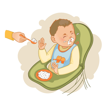 Baby boy sitting in the baby chair refuses to eat pap Stock Illustratie