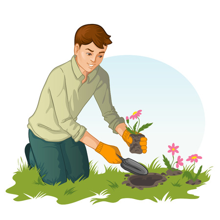 Young man planting flowers in garden