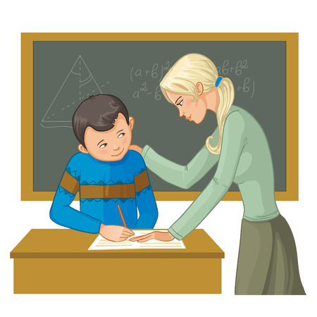 helps: Teacher helps a boy in classroom to resolve tasks during lesson