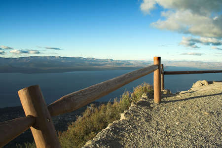 fence and lake photo