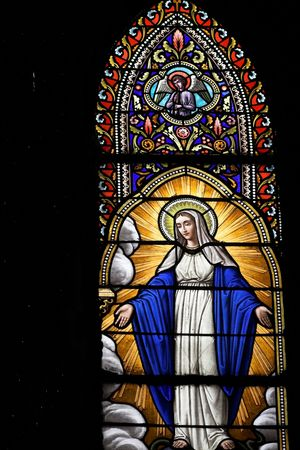 stained glass window with of saint mary. taken in a church