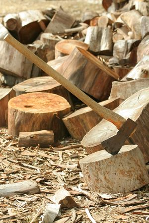 Axe and piles of wood photo
