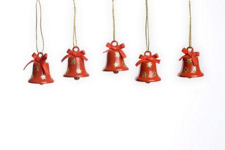 christmas bells hanging on white. horizontal image. photo