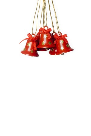 jingling: group of tinkle bells isolated in white.vertical image Stock Photo