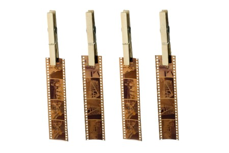four camera films hanging with clothespin. horizontal image. photo