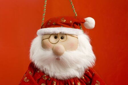 santa claus christmas doll, close-up. red background. horizontal image. Stock Photo - 4030671