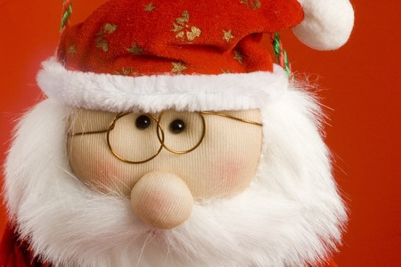 santa claus toy. face close-up. chistmas ornament. horizontal image. photo