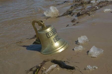 Ship bell of Titanic ship in sand photo