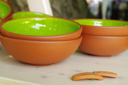 artisans: green clay pottery plates on table  at the fair of artisans in Riga