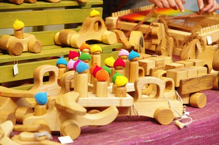 artisans: wooden hand made toy cars at the fair of artisans in Riga Stock Photo