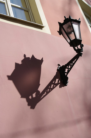 vintage lamp on the pink wall in Old Riga photo