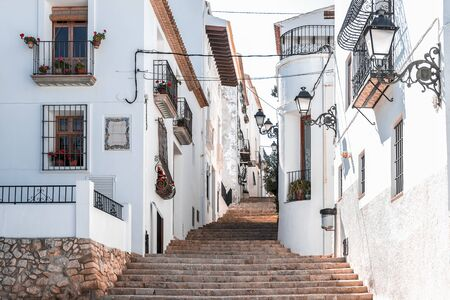 Street of a snow-white southern town on the hills, Costa Blanca Coast, province of Alicante, Spain, Apr.2019