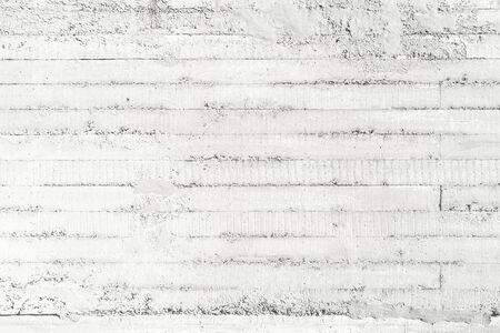 Concrete slab with formwork imprint. White horizontal pattern