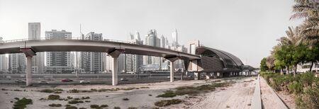 Dubai cityscape panorama. Resort area with transportation hub on Sheikh Zayed Road. Overhead Railway, Metro, Dubai, UAE