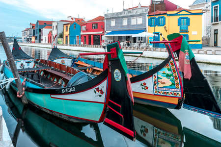 Aveiro, Portugal - Nov. 2019: Traditional boats on the water channel in the town of Aveiro. Colorful boats for tourists pleasure