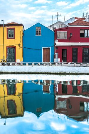 Coastal street with bright colorful houses that are reflected in the water, Aveiro, Portugal, Nov. 2019 Banco de Imagens