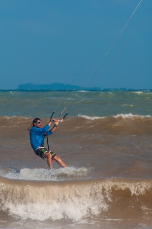 kitesurfing on the waves of the Chumpon in Thailand