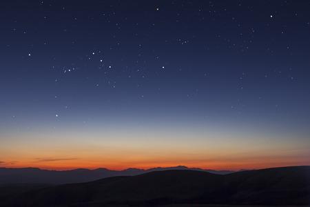 sterren en zonsondergang Stockfoto