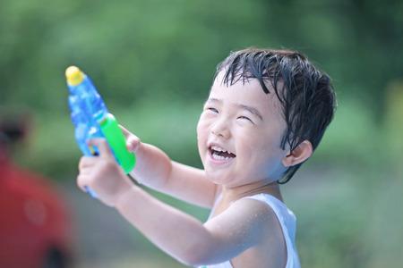 water gun: Boy playing in the water gun