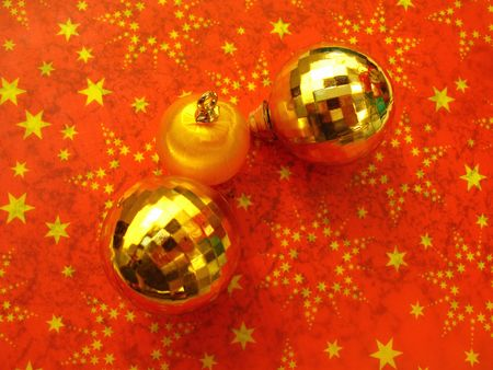 hollidays: Three Christmas balls on red background with stars Stock Photo