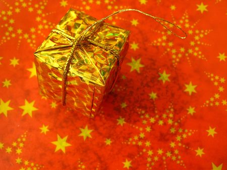 Golden box on red background with stars Stock Photo - 3591818