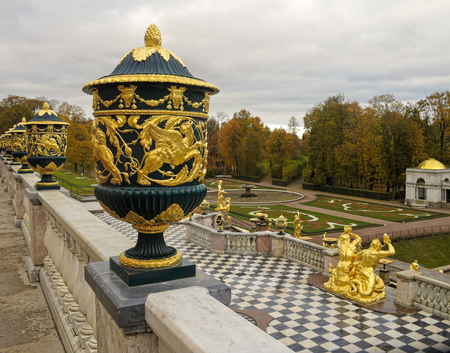 pomp: Vase with golden lions and flowers on the terrace of Grand Peterhof Palace. Grand Cascade, Peterhof. Russia, St.Petersburg.