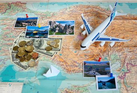 Travel concept plan and prepare for the trip to Turkey. Money, plane, pictures on the map with the background of the Russian language (Selective focus).