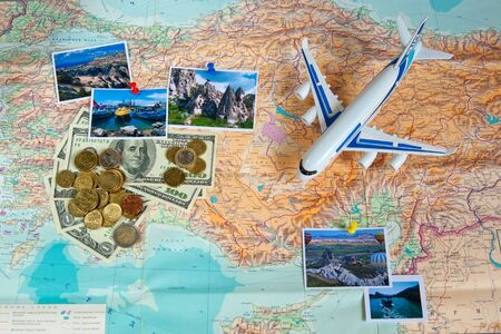 Travel concept plan and prepare for the journey to Turkey. Money, plane and pictures on the map with the background of the Russian language.