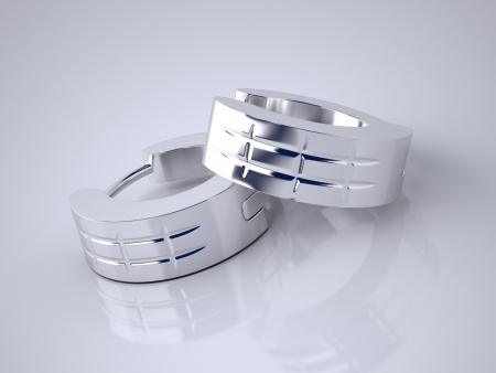 The Three-dimensional Earrings Made of White Gold Stock Photo