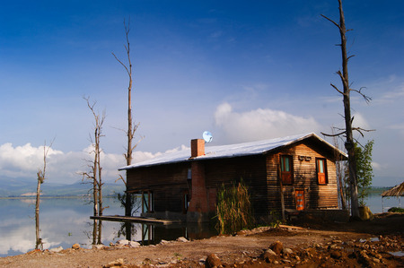 WOOD HUT ON THE SHORE OF THE LAKE
