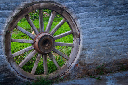decorates: An old wood wheel decorates the wall Stock Photo