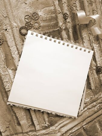 notepad for the sketch against the background of in retro style, sepia 免版税图像