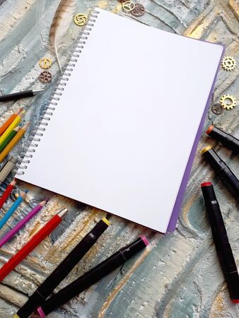 notebook for the sketch on a colourful background