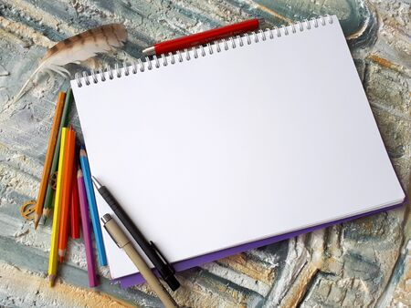 Photo of empty notepad for drawing on beautiful background with decor elements, for messages and entryes 免版税图像