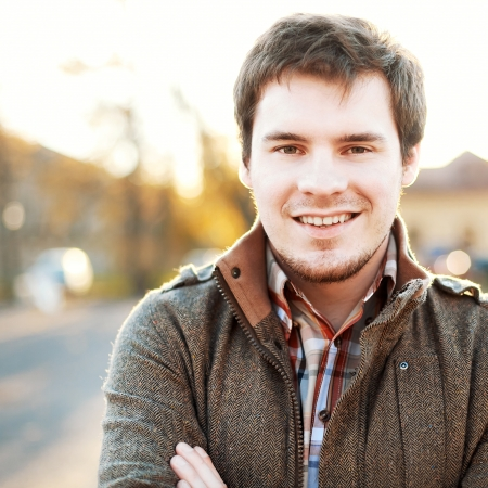 and the horizontal man: Handsome man outdoors portrait. Autumn colors.