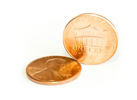 pennies: A closeup image of two pennies set in an innovative manner  The image has a shallow Depth-of-Field