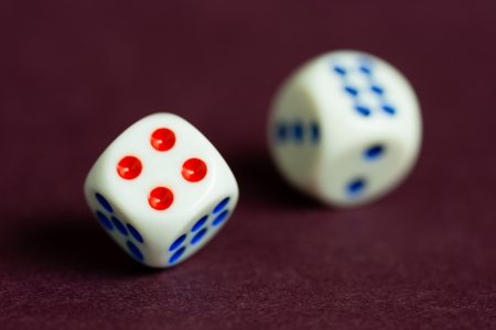 unclear: A concept suggesting a lack of clarity when taking chances  A pair of dice in motion and a shallow Depth-of-Field is used to portray an unclear outlook  Stock Photo