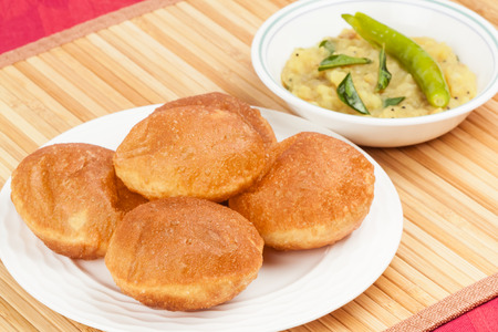 Delicious deep fried poori  puri  served with spicy potato onion curry  saagu Stock Photo - 26791237
