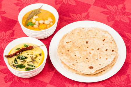 Homemade chapati Indian bread served with Dal and Indian vegetable curry The curry is prepared using carrots, beans and various spices