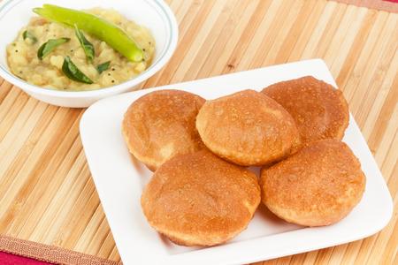 puri: Delicious deep fried poori  puri  served with spicy potato onion curry  saagu