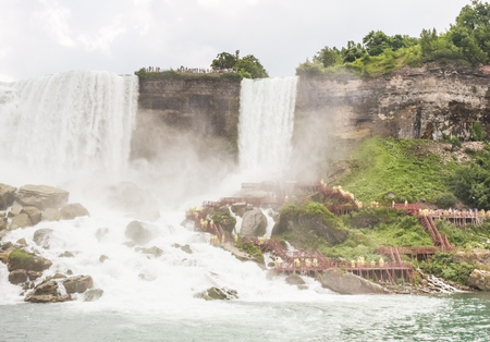 The Cave of the Winds and the Bridal Veil falls of the Niagara falls taken from a boat  photo