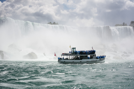 Niagara Falls, USA - July 16, 2009  Tourists aboard the Maid of the Mist boat take a closer look at the American Falls of Niagara