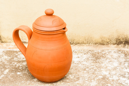 An earthenware water jug used to keep water cool in summer  Stock Photo