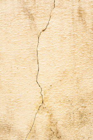 Old cement plastered wall that is cracked  photo