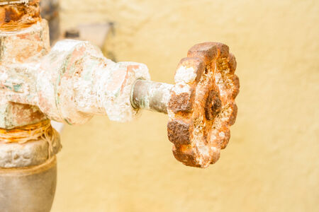 stop gate valve: Closeup view of a gate valve that is covered with rust