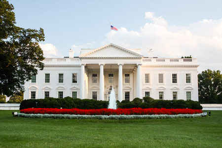 White House, the official residence of the President of the United States in Washington, D C  lit by the setting sun in the evening  Фото со стока